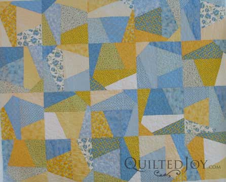 Linda brought me this fun and funky quilt that I think is a Split Nine Patch. The best quilting for a busy quilt is usually an edge to edge design. I looked for a pattern that would be whimsical and funky just like this quilt!