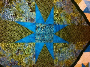 Sashing Stars on Quilt
