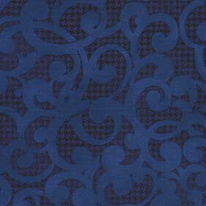 "Filigree in Navy Blue from Studio E. The print has a blue filigree scroll over a much darker navy blue textured background. 108"" wide back fabric. Available at QuiltedJoy.com"