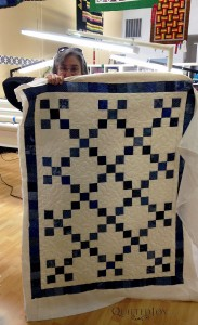 Kathleen's scrap quilt for her rental certification class at Quilted Joy