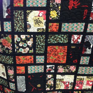 Shirley used a black omni thread for her Asian inspired quilt