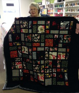Shirley shows off her completed quilt