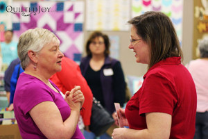 Angela speaking with quilters at QDO Lexington