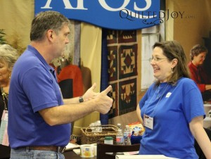 """The APQS team """"working hard"""" at the booth"""