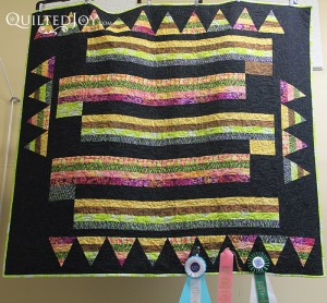 Broken Pencils Quilt hanging in the Quilted Joy showroom