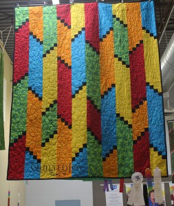 Rainbow Escape, hanging in the Quilted Joy Showroom