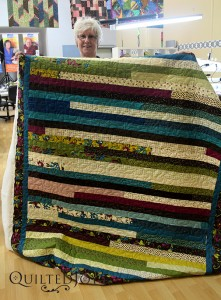 Charlotte's jelly roll quilt, quilted at Quilted Joy