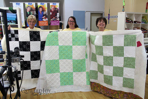 Debra, Rose, and Shirley show off their quilts after their rental certification class - QuiltedJoy.com