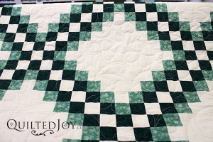 Irish Chain Quilt with shamrock edge to edge quilting by Angela Huffman - QuiltedJoy.com