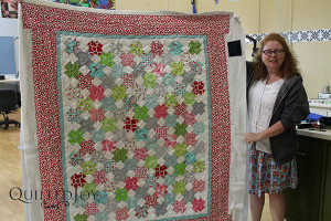 Maggie shows off her quilt after renting the APQS Millie - QuiltedJoy.com