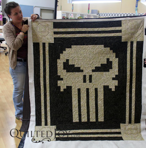 Marie shows off her Punisher quilt - QuiltedJoy.com