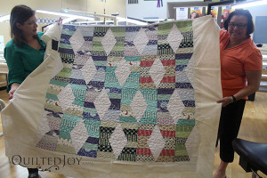 Pam shows off her quilt after renting the APQS Millie - QuiltedJoy.com