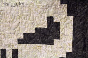 Marie's punisher quilt with freehand meandering - QuiltedJoy.com