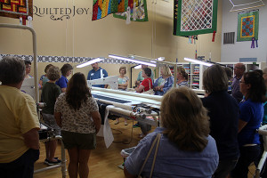 Angela demonstrates on the Millie at the APQS Road Show - QuiltedJoy.com