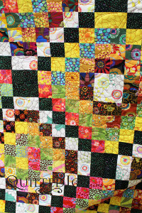 Gorgeous and colorful Trip Around the World Quilt - QuiltedJoy.com