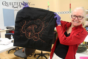 Debbie shows off her sample in the Peacock Paisley Party class