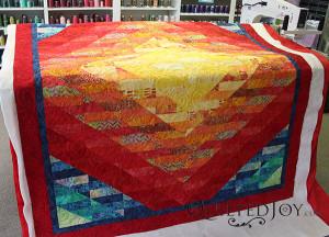 Arlene's Batik Sunrise with quilting by Angela Huffman