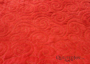 Jessica Schick's Swirls Pantograph on Arlene's Batik Sunrise with quilting by Angela Huffman - QuiltedJoy.com