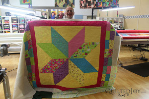 Bill made this baby quilt for his coworker's newborn - QuiltedJoy.com