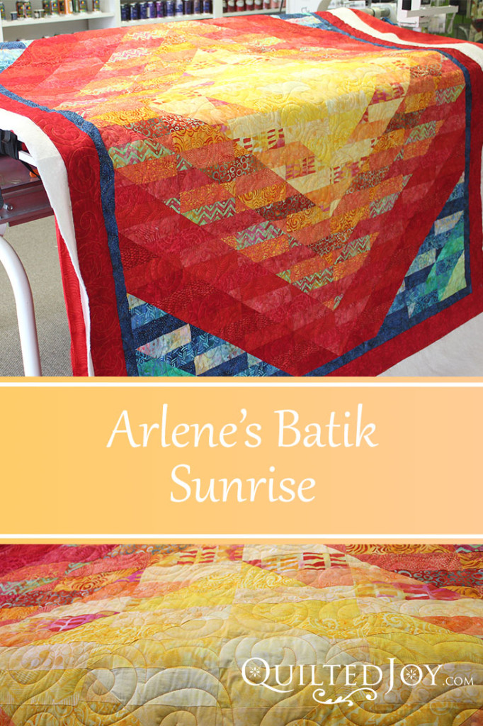 Arlene's Batik Sunrise with quilting by Angela Huffman - QuiltedJoy.com