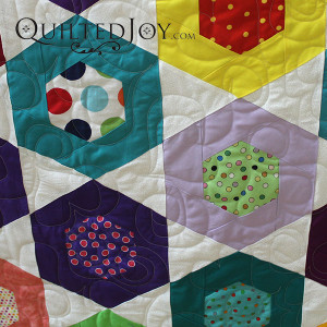 There are so many ways to fill in a hexagon. How do you quilt this common shape? - QuiltedJoy.com