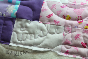 Colleen used the APQS Millie to stitch out her granddaughter's name on the quilt! - QuiltedJoy.com