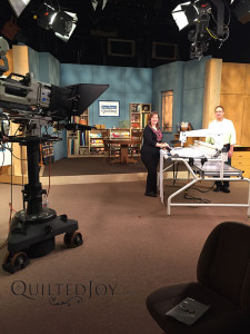 Angela on the set of Love of Quilting with guest host Patrick Lose - QuiltedJoy.com