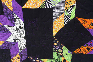 Polly designed her own Halloween pantograph for this quilt - QuiltedJoy.com