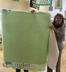 Would you believe this was Lyvonn's first time using a longarm quilting machine? You don't have to be a pro to quilt feathers with the help of our design boards! - QuiltedJoy.com
