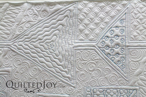 How would you quilt these triangles? Join the Ohio Valley Longarm Guild for their January 2016 program on quilting triangles - QuiltedJoy.com