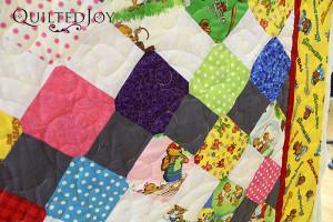 Teddy bear quilting design on a Berenstein Bears baby quilt - QuiltedJoy.com