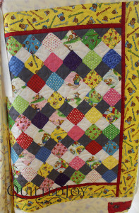 Berenstein Bears baby quilt, quilted at the Quilted Joy showroom.