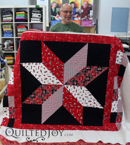 Lemoyne star quilt with U of L novelty fabrics. - QuiltedJoy.com