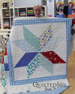 Bill's Lemoyne star quilt with wintery fabrics. - QuiltedJoy.com
