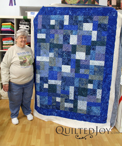 Luscious blue batik fabrics in this gorgeous quilt. - QuiltedJoy.com