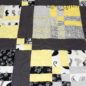 Fun moustache fabrics for a man's quilt - QuiltedJoy.com