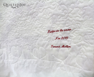 The snowflake design looks amazing on the back of Tammie's Tulips in the Snow quilt - QuiltedJoy.com