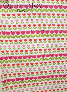 Tulip fabric for the back of a baby quilt - QuiltedJoy.com