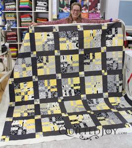Fun mustache fabrics for a man's quilt - QuiltedJoy.com