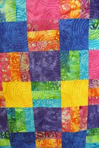 The colors in Sandy's batik lap quilt were stunning!