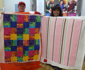 Renee and Sandy show off their finished quilts after their rental certification class - QuiltedJoy.com