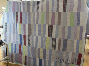 Each strip in this quilt was made from Erin's husband's shirts. What a fun take on the t-shirt quilt that also encourages you to replace old work shirts! - QuiltedJoy.com