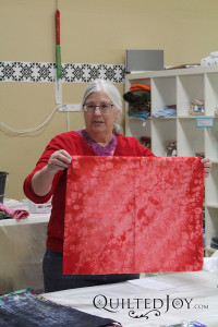 Pat shows off the results of her manipulations at the Dip, Dye, and Dabble Day Camp