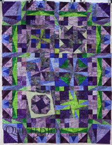 Karee's abstract sampler quilt. Longarm quilting by Angela Huffman with the Lake Susan Pantograph - QuiltedJoy.com