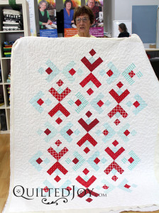 Carol called this quilt Snowflakes and used our meander design board to quilt it during her rental at Quilted Joy.