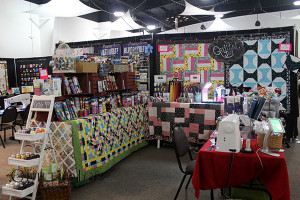 Wide shot of the Quilted Joy booth at KY QDO