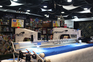 The APQS Lenni and Lucey set up for test drives at a trade show