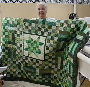 After two years of waiting, Jane was finally able to quilt this green batik quilt with a longarm rental at Quilted Joy