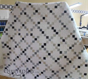 Single Irish Chain quilt in neutral colors. Lyvonn quilted with a design board on an APQS longarm machine at Quilted Joy.