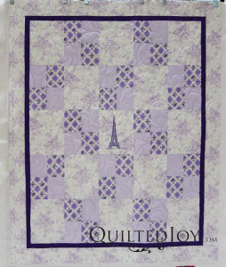 The Purple Parisian is an alternating four patch quilt with a fun Parisian theme. Quilting by Angela Huffman